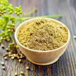 coriander-powder-bowl-board-umbrella-immature-green-seeds-background-wooden-boards-64701452